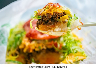 taco filling and rice in Okinawa Prefecture, Japan. Taco rice is a dish of Okinawa Prefecture with ingredients of tacos of Mexican-style American cuisine on rice.