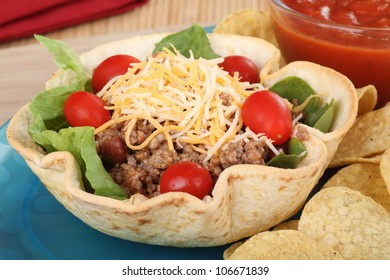 Taco salad with cherry tomatoes in tortilla shell