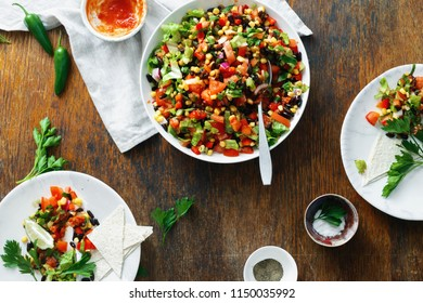 Taco salad on a wooden table, top view. Dinner table concept