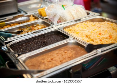Taco stand food with beans and rice