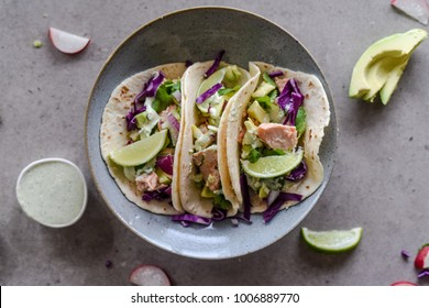 Taco Tuesday - Salmon and Avocado Tacos served with red cabbage slaw and lime