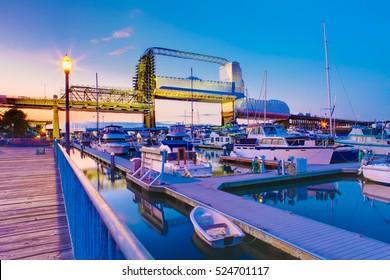 Tacoma downtown marina with bridge and pier during twilight. WA