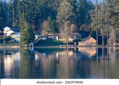 Tacoma lake in the Puget Sound of the Pacific Northwest with housing in spring