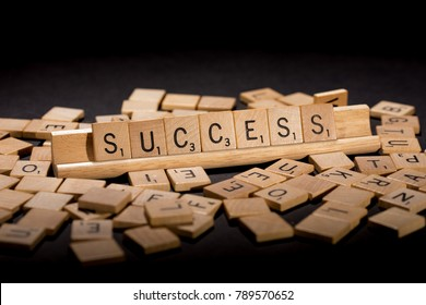 "TACOMA, WA, JANUARY 8, 2018: Originally invented in 1938 by American architect Alfred Mosher Butts, letters of the popular board game Scrabble spell the seven-letter word ""Success."""