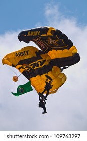 TACOMA, WA - JULY 21: The US Army Golden Knights Parachute Team demonstrate tandem parachuting during Air Expo at McChord Field Joint Base Lewis-McChord on July 21, 2012 in Tacoma, WA.