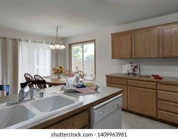 Tacoma, WA / USA - May 24, 2019: Modern kitchen and dining room interior