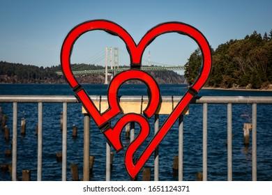 Tacoma, Washington, USA, February 18, 2020. 253 heart at Titlow beach park with Tacoma Narrows bridge in back ground,