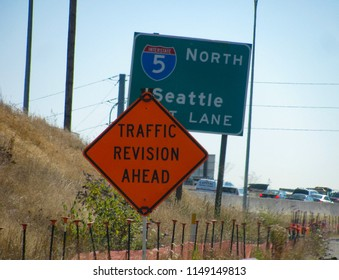 Tacoma, Washington USA – July 26, 2018: For cars crawling in gridlock on a hot, hazy summer commute, a sign promising traffic revision ahead provides a bit of humor.
