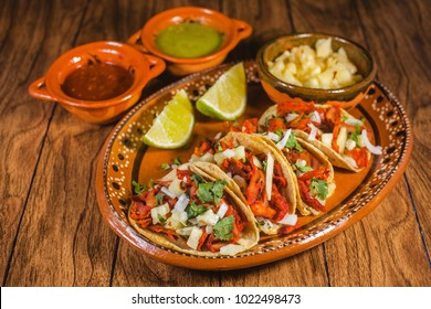 tacos al pastor and spicy sauce mexican food in mexico city