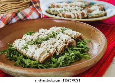 tacos dorados, flautas de pollo, chicken tacos and spicy Salsa Homemade Mexican food in mexico