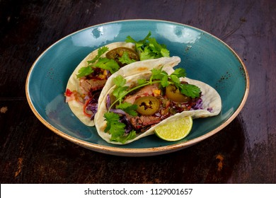 Tacos with meat and coriander leaves