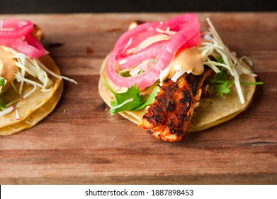 Tacos. Meat, fried fish, avocado, cilantro, cheese, homemade salsa, lettuce and lime slices. Tex-Mex favorite, Mexican street tacos: beef, fish, pork, served on homemade corn tortillas.