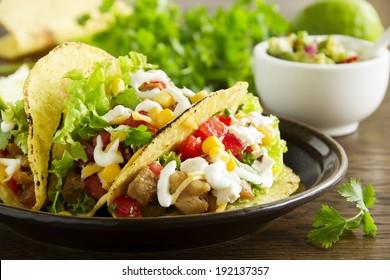 Tacos with pork and tomato salsa.