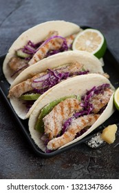 Tacos with red cabbage, grilled chicken, avocado, lime and cheese. Selective focus, studio shot