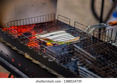 tacos with vegetables are grilled on the open fire of the brazier