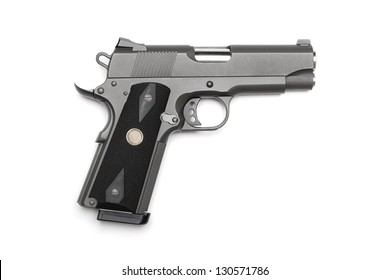 """Tactical 1911, 4"""" pistol on a white background. Studio shot"""