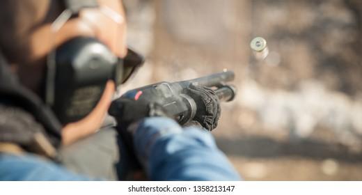 Tactical combat pump gun shooting training. Shotgun weapon action course. Outdoor shooting range