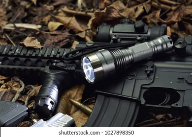 Tactical flash light and assault rifle gun weapon. LED Pocket flashlight.