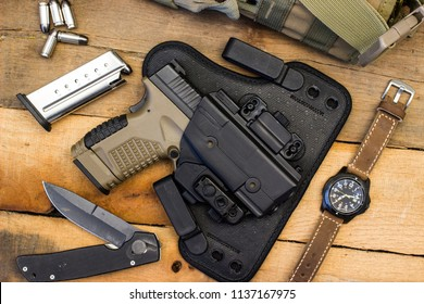 Tactical Gear Such as Semi Automatic Handgun, Knife, Watch, and Concealed Carry Holster