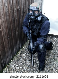 tactical officer with gas mask