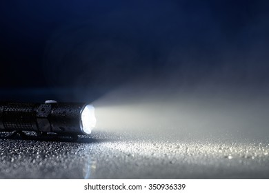 Tactical waterproof flashlight with water drops and fog
