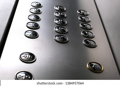 Tactile digit icons for the visually impaired. Elevator buttons. Selective focus close-up.