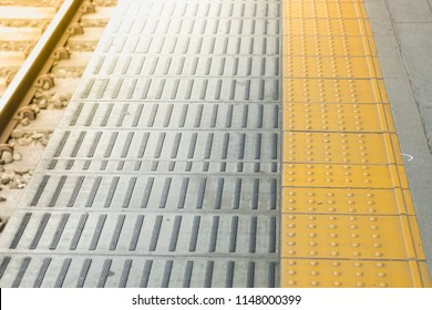 Tactile paving for blind handicap on tiles pathway, walkway for blindness people with train railway