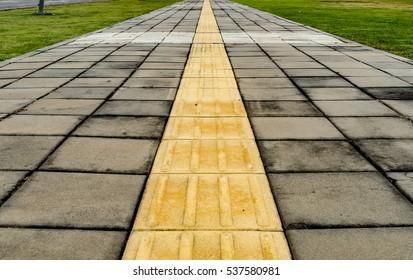 Tactile paving for blind handicap on concrete block pathway