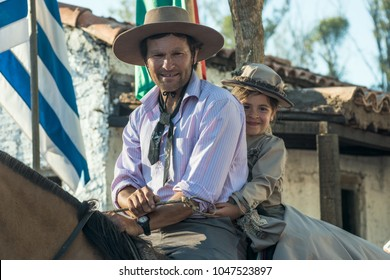 "Tacuarembo, Uruguay - March 9, 2018: Gauchos (South American cowboys) poses during the Traditional Gauchos Feast ""Patria del Gaucho"". Gaucho is a resident of the South American pampas"