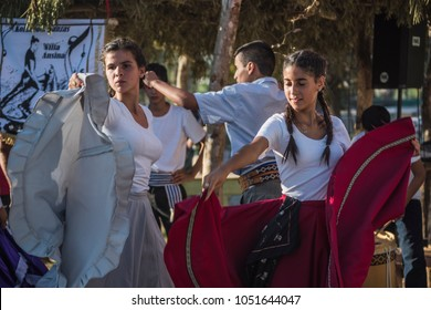 "Tacuarembo, Uruguay - March 9, 2018: Gauchos (South American cowboys) dancing at the annual Traditional Gauchos Feast ""Patria del Gaucho"". Gaucho is a resident of the South American pampas"