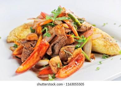 Tacu-tacu con lomo saltado, peruvian food.