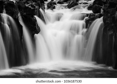 Tad Pha Suam waterfall in Laos. Waterfall in black and white.