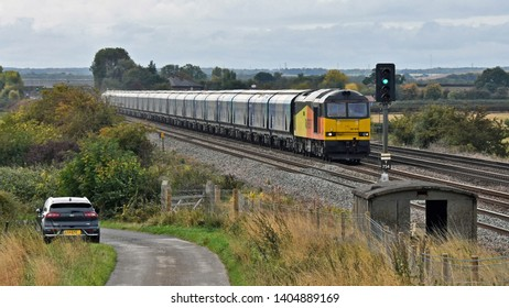 Tadcaster UK Oct 6th 2018 a train of empty biomass hoppers returning northwards after delivering its load of biomass to Drax Power Station for the generation of electricity