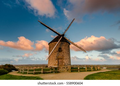 Taditional ancient windmill Moidrey in scenic fields on hill top in Pontorson,France.