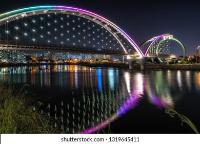 Taehwa Bridge taken at night. Taehwa Bridge is located in Taehwagang river grand park in Ulsan, South Korea.