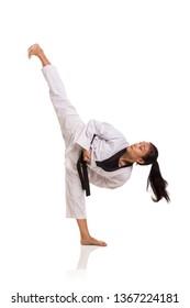 Taekwondo girl high kick, full length portrait isolated over white background