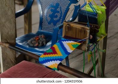 Tafi Abuife Kente Village, Volta Region, Ghana - September the 17th 2018. A traditional kente cloth in a workshop.