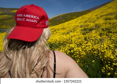 Taft, California - March 25, 2019: Blonde woman wearing a Donald Trump Make America Great Again hat, sitting in a field of yellow wildflowers. Concept for the 2020 United States Presidential Election
