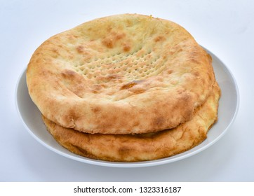 Taftan, A soft, little sweet and oily flat bread baked in pakistani clay oven