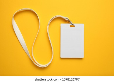 Tag id pass, plastic identification on yellow background. White blank badge mockup.