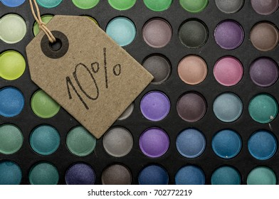 Tag placed on colorful makeup palettes writing 10 percent discount