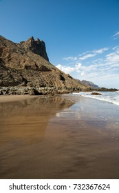Taganana beach reflections in the sand on a sunny day in Tenerife Spain