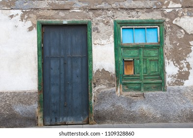 Taganana. Tenerife / Spain - 25.10.2017   : old shabby wall of a house with closed wooden window and a door