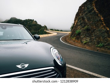 Taganana, Tenerife, Spain - May 31, 2017: Car close-up is on winding road im mist on north of Tenerife. Canary Islands, Spain