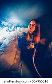 TAGANROG, RUSSIAN FEDERATION - January 14, 2017.. Sexy girl smokes a hookah in a night club