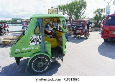 Tagbilaran Bohol Philippines - May 21, 2015 : Tricycle bike taxi at Tagbilaran street Bohol Island. Tricycle are the most popular public transportation in the Philippines.