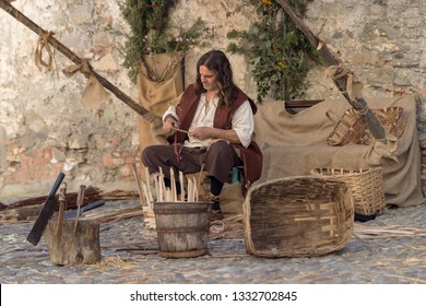 Taggia, Italy - February 24, 2019: Participant of historical reenactment in the old town of Taggia, in Liguria region of Italy