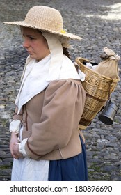 TAGGIA-IMPERIA, ITALY - MARCH 2: An unidentified young woman participates of medieval costume party in the historic city of Taggia, Italy on March 2, 2014.