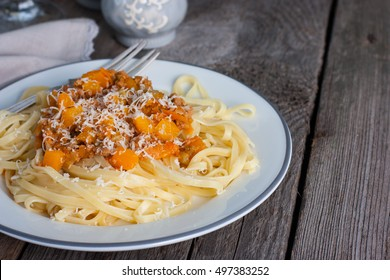 tagliatelle with bolognese sauce with pumpkin and cheese, copy space