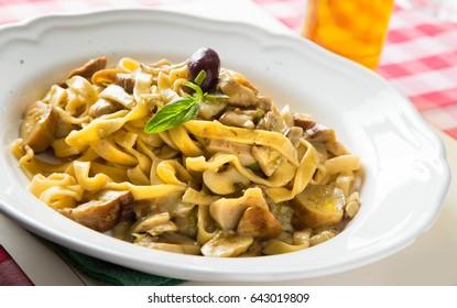 Tagliatelle con Funghi italian restaurant shot of authentic Napoli dish
